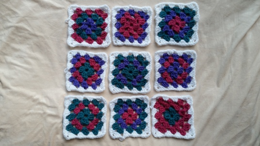 Nine completed  multicoloured squares with white borders