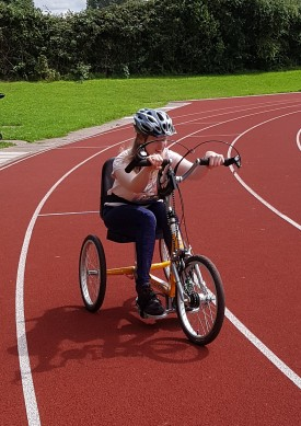 Jennie on hand cycle.jpg